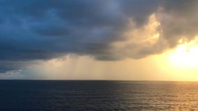 Beautiful peaceful ocean horizon colorful blue skies pan to a golden hour stock footage