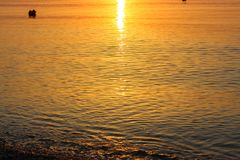 Beautiful and Peaceful Reflexion of the Sun in the Sea at Sunris. E Stock Photos