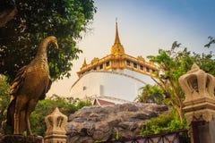 Beautiful peacock sculpture at front of Wat Saket Ratcha Wora Ma. Ha Wihan (Wat Phu Khao Thong, Golden Mount temple), a popular Bangkok tourist attraction and Stock Photo