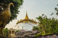 Beautiful peacock sculpture at front of Wat Saket Ratcha Wora Ma. Ha Wihan (Wat Phu Khao Thong, Golden Mount temple), a popular Bangkok tourist attraction and Royalty Free Stock Photo