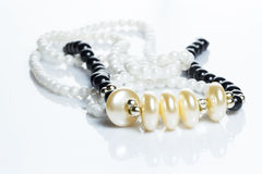 Beautiful pearl necklace. Pearl necklace over white background Royalty Free Stock Images