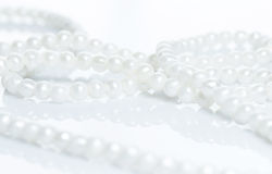 Beautiful pearl necklace. Pearl necklace over white background Stock Photo