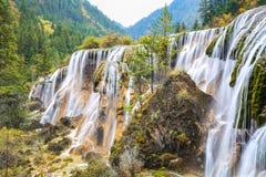 Beautiful pearls beach waterfall in autumn Stock Photo