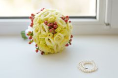 Beautiful pearls and wedding bouquet Royalty Free Stock Image