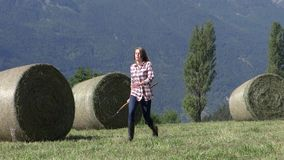 Beautiful peasant girl with pitchfork stock footage