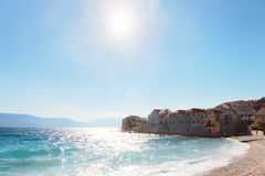 Beautiful pebble beach in a small town on Brac island - Croatia Stock Photos