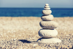 Beautiful pebble stack on a sandy beach Royalty Free Stock Photography