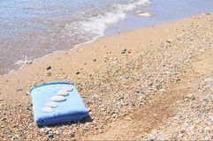 Beautiful  pebbles on the nice towel. Royalty Free Stock Photos