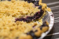 Beautiful American style blueberry pie with one slice missing stock photo