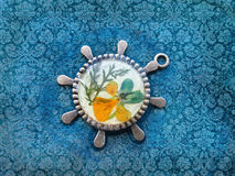 Beautiful pendant with flowers in resin. Women's jewelry, Stock Photo
