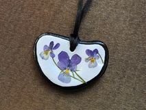Pendant made using natural stone and dry flowers Stock Photography
