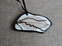 Beautiful pendant made using stone  and leaf skeleton Stock Images