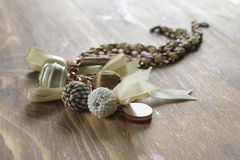 Beautiful pendent  with beads and ribbons Stock Photography