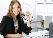Beautiful pensive businesswoman sitting at her working place Royalty Free Stock Photography