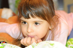 Beautiful pensive girl smiling Royalty Free Stock Photos