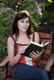 Beautiful Pensive Girls Reading a Book Stock Images