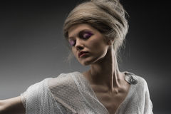 Beautiful pensive glamour girl creative hairstyle. Fashion beautiful glamour girl with creative stylized hair Stock Photos
