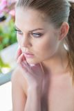 Beautiful pensive woman with bare shoulders Stock Photography
