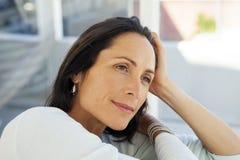 Beautiful pensive woman - close up portrait royalty free stock photos