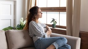 Free Beautiful Pensive Woman Looking Out Window While Resting On Couch Royalty Free Stock Photo - 195481635