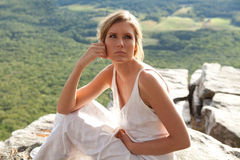 Beautiful Pensive Woman on Mountaintop Royalty Free Stock Photos