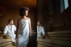 People pursuing healthy lifestyles relaxing in sauna royalty free stock images