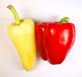 Beautiful peppers. Red and yellow peppers isolated on white stock images