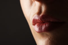 Beautiful Perfect Lips. Beauty young woman Lips. Close up over black background Stock Image