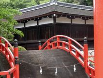 Beautiful red bridge in the garden of a Japanese Shinto shrine. Beautiful and perfect red bridge in the garden of a Japanese Shinto shrine in Japan royalty free stock photos