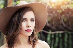 Beautiful perfect woman face outdoors. Pretty girl in hat, lifestyle portrait stock photo