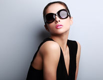 Beautiful perfect young woman posing in fashion sunglasses Royalty Free Stock Image