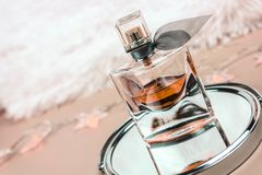 Beautiful perfume in reflection stock image
