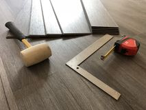 Beautiful perspective shot of the newly installed luxury floor with the tools on it. royalty free stock photos