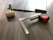 Beautiful perspective shot of the newly installed luxury floor with the tools on it. royalty free stock photography