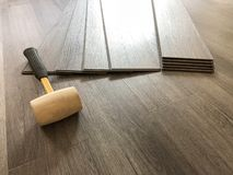Beautiful perspective shot of the newly installed luxury floor with the tools on it. stock images