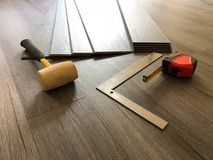 Beautiful perspective shot of the newly installed luxury floor with the tools on it. stock image