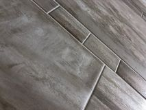 Beautiful perspective shot of the newly installed luxury tile floor . royalty free stock photography