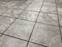 Prospective shot of the newly installed tile floor. Beautiful perspective shot of the newly installed luxury tiles. Close up of floor tiles royalty free stock image