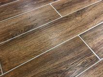 Beautiful perspective shot of the newly installed modern tile floor . royalty free stock image