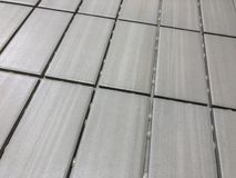 Beautiful perspective shot of the newly installed modern tile floor . royalty free stock photography