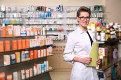 Beautiful pharmacist Stock Images