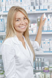 Beautiful pharmacist choosing the product Stock Image