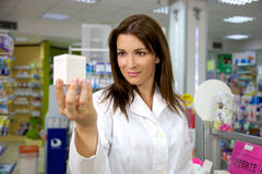 Beautiful pharmacist observing medicine Royalty Free Stock Photography