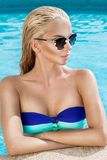 Beautiful phenomenal stunning elegant luxury sexy blonde model woman with perfect face wearing a sunglasses stands with elegant sw Royalty Free Stock Photos