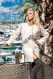 Beautiful phenomenal stunning  elegant luxury sexy blonde model woman wearing a coat and boots and sunglasses. Beautiful phenomenal stunning elegant luxury sexy Stock Photos