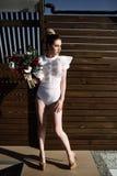 Beautiful phenomenal stunning elegant blonde model with perfect erotic body suit Stock Photo