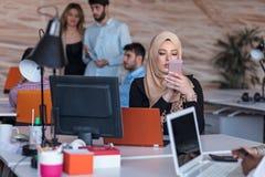 Beautiful phone operator Arab woman working in modern startup office. Beautiful phone operator Arab women working in modern startup office Stock Photos