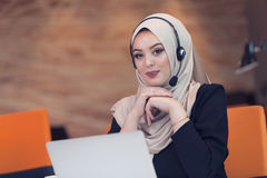 Beautiful phone operator arab woman working in startup office Royalty Free Stock Image