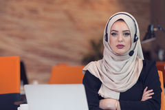 Beautiful phone operator arab woman working in startup office Stock Photography