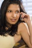 Beautiful Phonecall. A beautiful young Hispanic woman enjoying a call on her mobile phone Royalty Free Stock Image